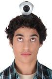 Tonåring med en webcam Arkivbild