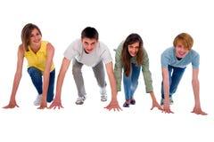 Tonåringar på starta raster Arkivfoto