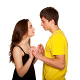 Tonåringar pojke och förälskat se för flicka vänder mot - - vänder mot Royaltyfri Bild