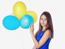 Tonåringflicka med baloons royaltyfri bild