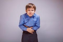 Tonåringpojke 10 år av det europeiska utseendet Arkivfoton
