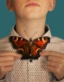 Tonåringpojke med fjärilsflugan royaltyfri bild