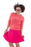 Tonårs- flicka för härlig afrikansk amerikan i rosa färger Arkivbild
