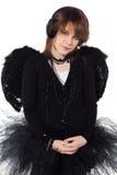 Tonårs- flicka i dräkt av den svarta ängeln Royaltyfria Bilder