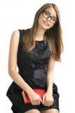 Tonårs- flicka i exponeringsglas med böcker Royaltyfria Foton