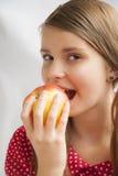 Tonårs- flicka med Apple Royaltyfria Foton