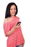 Tonårs- flicka med den smart telefonen Royaltyfri Fotografi