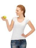 Tonårs- flicka med det gröna äpplet royaltyfri fotografi