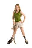 Tonårs- flicka med en skateboard Arkivbild
