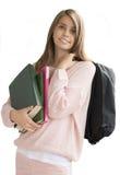 Tonårs- flicka med skolapåsen Royaltyfria Foton