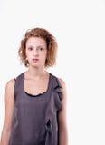 Tonårs- flicka på bakgrund för 255 white Arkivbild