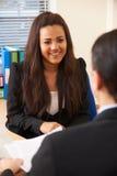 Tonårs- flicka som intervjuas för jobb royaltyfri bild