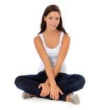 Tonårs- flicka som sitter på golvet Fotografering för Bildbyråer