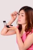 Tonårs- framsidasmink för asiatiska kvinnor Royaltyfria Foton