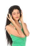 tonårs- head telefoner för flicka Arkivfoton