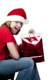 tonårs- julflickashopping Royaltyfria Bilder