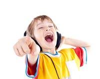 tonårs- lycklig hörlurar för pojke Royaltyfri Fotografi