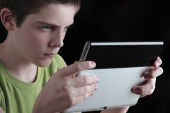 Tonårs- tidsfördriv Arkivfoto