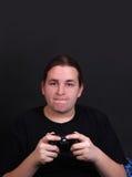 tonårs- video för modig spelare Arkivfoton