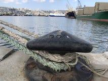50 Ton capacity. A 50 ton capacity bollard, with ship ropes around it Royalty Free Stock Photography