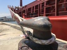50 Ton capacity. A ship rope attached to a 50 ton bollard Stock Photo