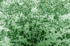 Tonad gräsplan rostade metallyttersida Arkivfoto