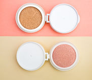 Tonal foundation and highlighter, base for make-up in the form of a cushion. stock photography