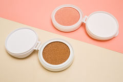 Tonal foundation and highlighter, base for make-up in the form of a cushion. Stock Photo