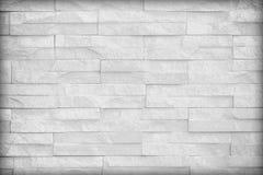 Tonar den vita väggen för yttersida av grå färger för stenväggen för bruk som backgroun Arkivbilder