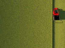 Tondeuse à gazon sur la zone verte Image stock