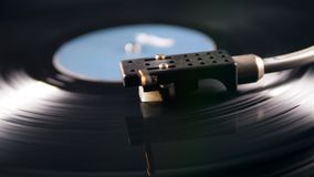 Tone arm is being put onto a static vinyl record. 4K stock video footage