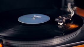 Tone arm is lowering onto the vinyl record. 4K stock footage