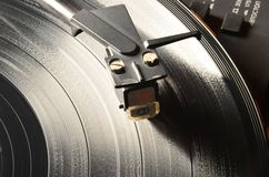 Tonearm on a vinyl record. Step between the grooves in vinyl, and its apparent width, is defined by the recorded sound Royalty Free Stock Photos