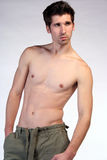 Toned body. A sexy male fitness model Royalty Free Stock Photography