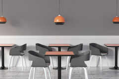 Toned cafe interior. With lamps, tables, chairs and copy space on concrete wall. 3D Rendering Royalty Free Stock Photo