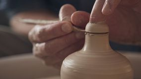 Toned cinematic, craft factory authentic. Traditional pottery making. Close up of hands working clay on potter`s wheel. Traditional pottery making, close up of stock video footage