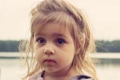 Toned closeup portrait of beautiful girl with big sad eyes Stock Images
