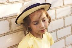 Toned Closeup portrait of sad  little girl dreaming. Stock Photo