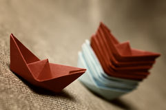 Toned colored paper boats glass Royalty Free Stock Images