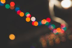 Toned. Colorful blurry lights. Yellow, blue, red. garland in blur. Night. Black background. Toned. Colorful blurry lights. Yellow blue red garland in blur Night stock photo