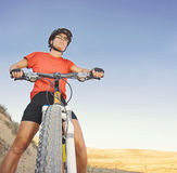 a toned girl on a mountain bike in the hills during summer at sunset Stock Photos