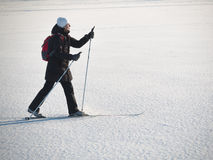 Toned image of an adult woman going skiing Stock Images
