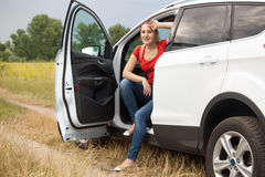Toned image of beautiful woman got lost while driving car in the Stock Photography
