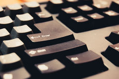 Toned image of computer keyboard with focus on enter key Royalty Free Stock Image