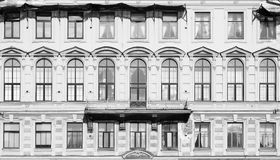 Toned image. Facade of an old building with large Windows and dilapidated walls Royalty Free Stock Photo