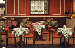 Toned image of italian restaurant interior with wooden chairs an Stock Images