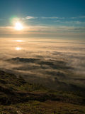 Toned image multicolored sunset above the clouds against the background of the Norwegian Sea Royalty Free Stock Image