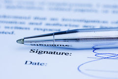 Toned image of signed document. Royalty Free Stock Images