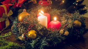 Toned image of three burning candles in decorative Christmas wreath Stock Images