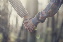 Toned image of two women holding hands Royalty Free Stock Photo